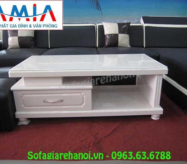 Hình ảnh mẫu bàn trà kính màu trắng đẹp hiện đại và sang trọng cho căn phòng khách gia đình