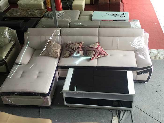 Hình ảnh mẫu ghế sofa da góc chữ L kết hợp với bàn trà kính đẹp